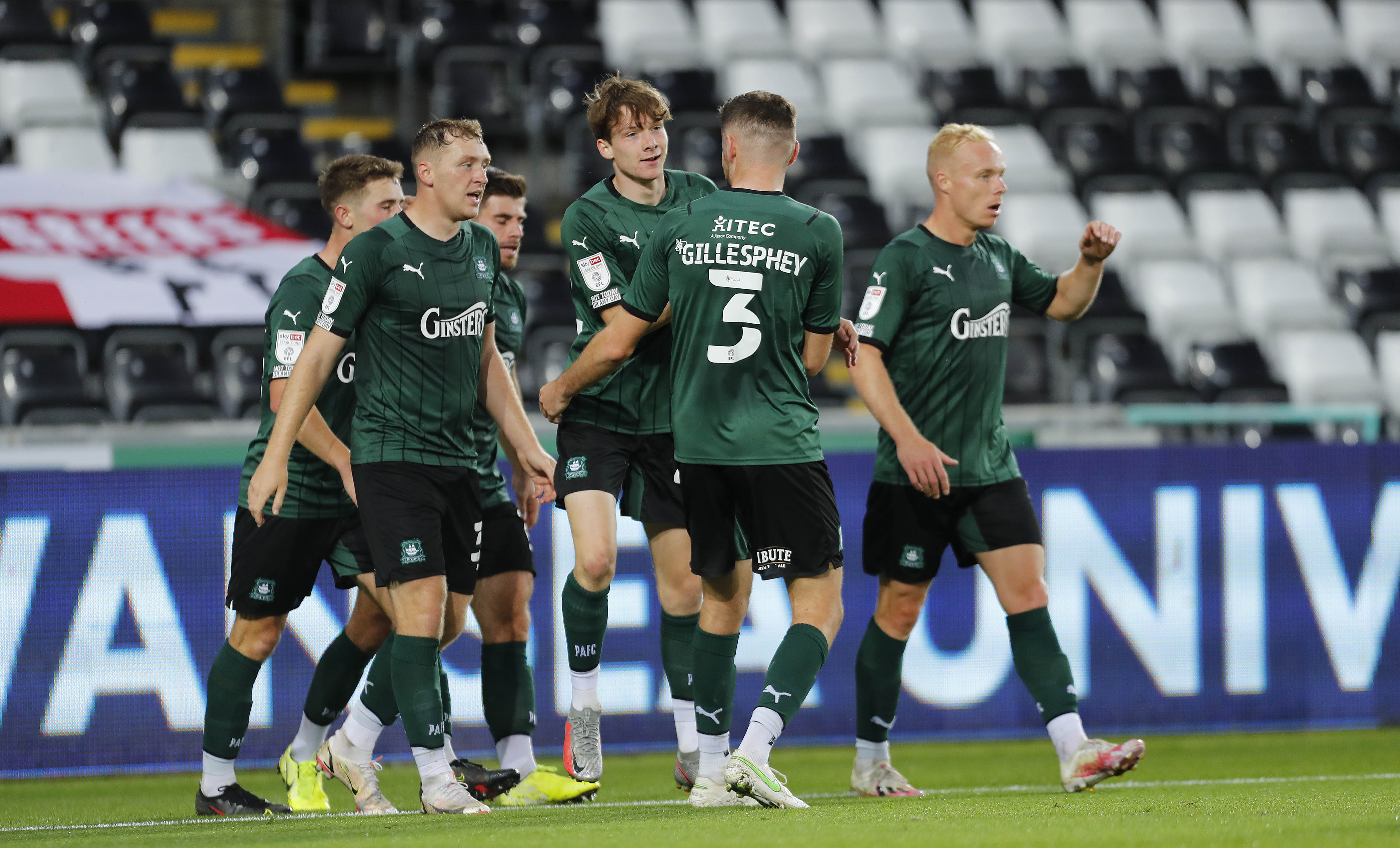 The players celebrate Rhys Shirley's goal