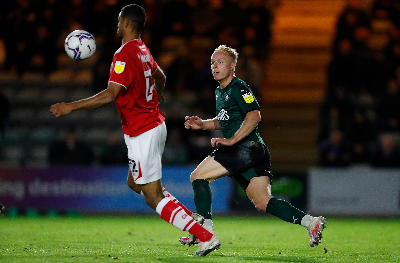 Ryan Broom taking on the Crewe defence
