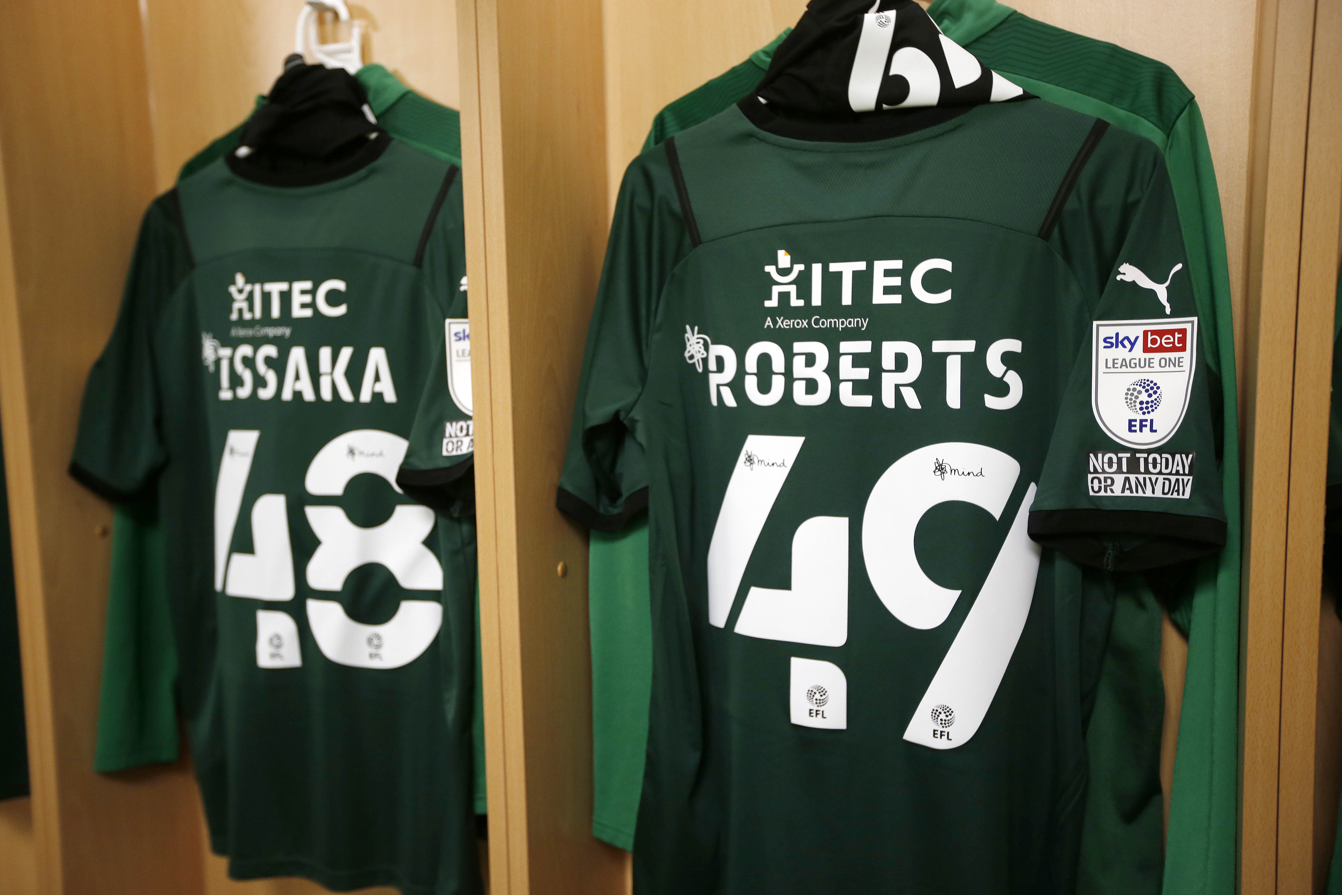 Freddie Issaka and Caleb Roberts' shirts up in the dressing room